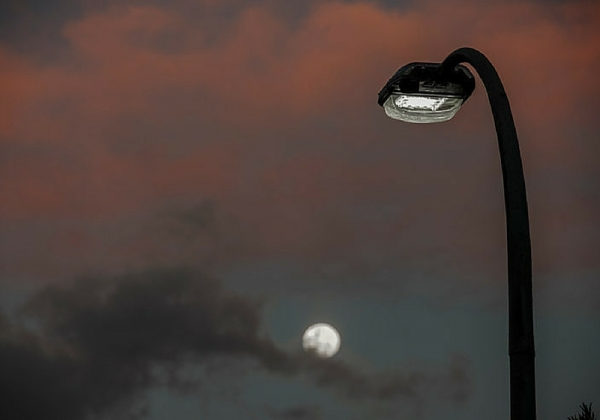 LED street light with moon rising behind