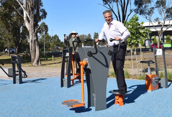 Mayor of Fairfield Frank Carbone, using free gym equipment in St Johns Park Oval, St Johns Park.
