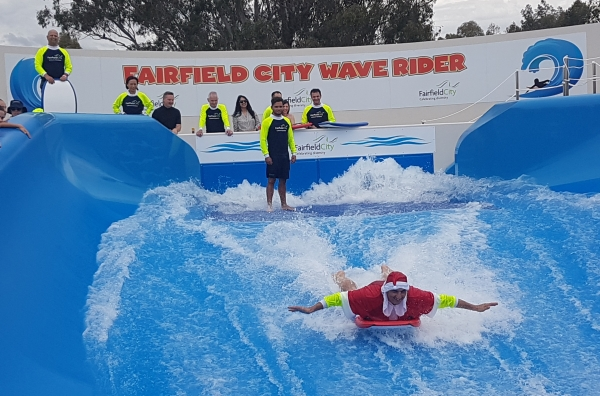 Mayor of Fairfield, Cr Frank Carbone trying out the new Fairfield City Wave Rider.